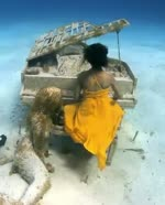 The mermaid and her piano at Rudder Cut Cay Island in Bahamas
